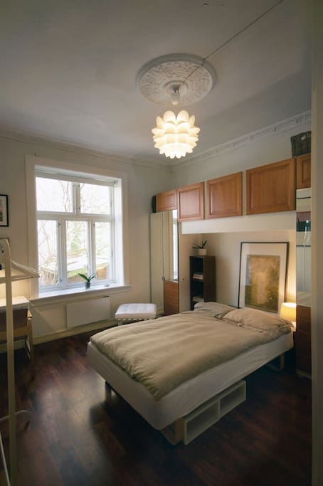 This will be your bedroom: a spacious, calm, cozy room with a queen sized bed.