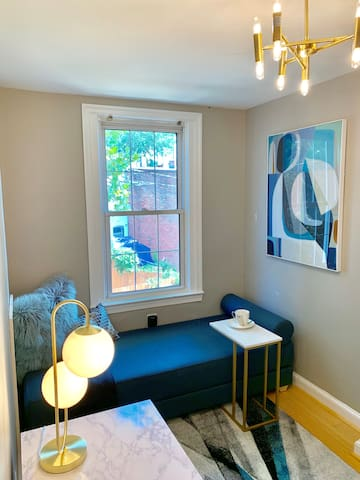 An office/small bedroom with a daybed that opens into a queen-size (tight fit in the room when opened)