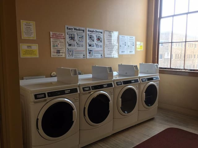 Laundry Room is 15ft away from the Loft. It is nice having access to 2 washers and 2 dryers. Dry Cleaner is across the Street as well.