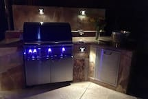 Stunning outdoor kitchen Lynx Grill set in copper top and Mediterranean stone...