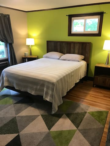 The green master bedroom has queen sized bed and an extra spacious closet.