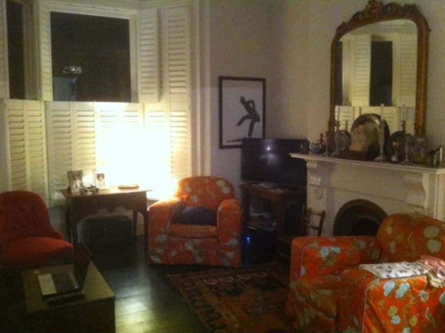 Sitting room with some antique furniture, widescreen TV and netflix etc