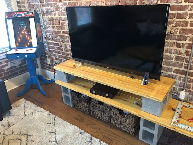 """Huge 55"""" TV included with sling cable, Netflix and availability to watch anything from this smart TV. Custom made console has baskets that store all of your favorite games: Full poker set, Monopoly, Twister, Connect 4, UNO, Simon and more!"""