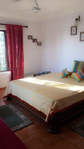 The brightly-lit bedroom with sunlight streaming in