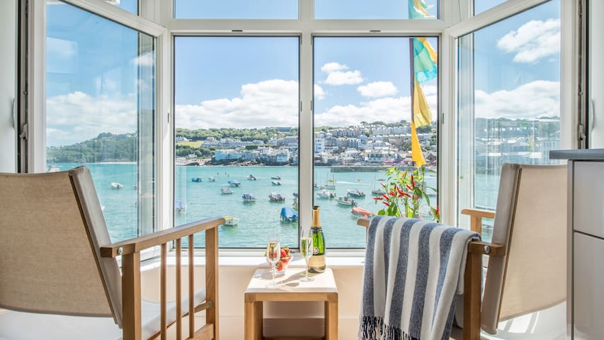 Two Harbour House, right on the Wharf seafront of St Ives overlooking the harbour and beach. Allocated parking in garage. Free WiFi.