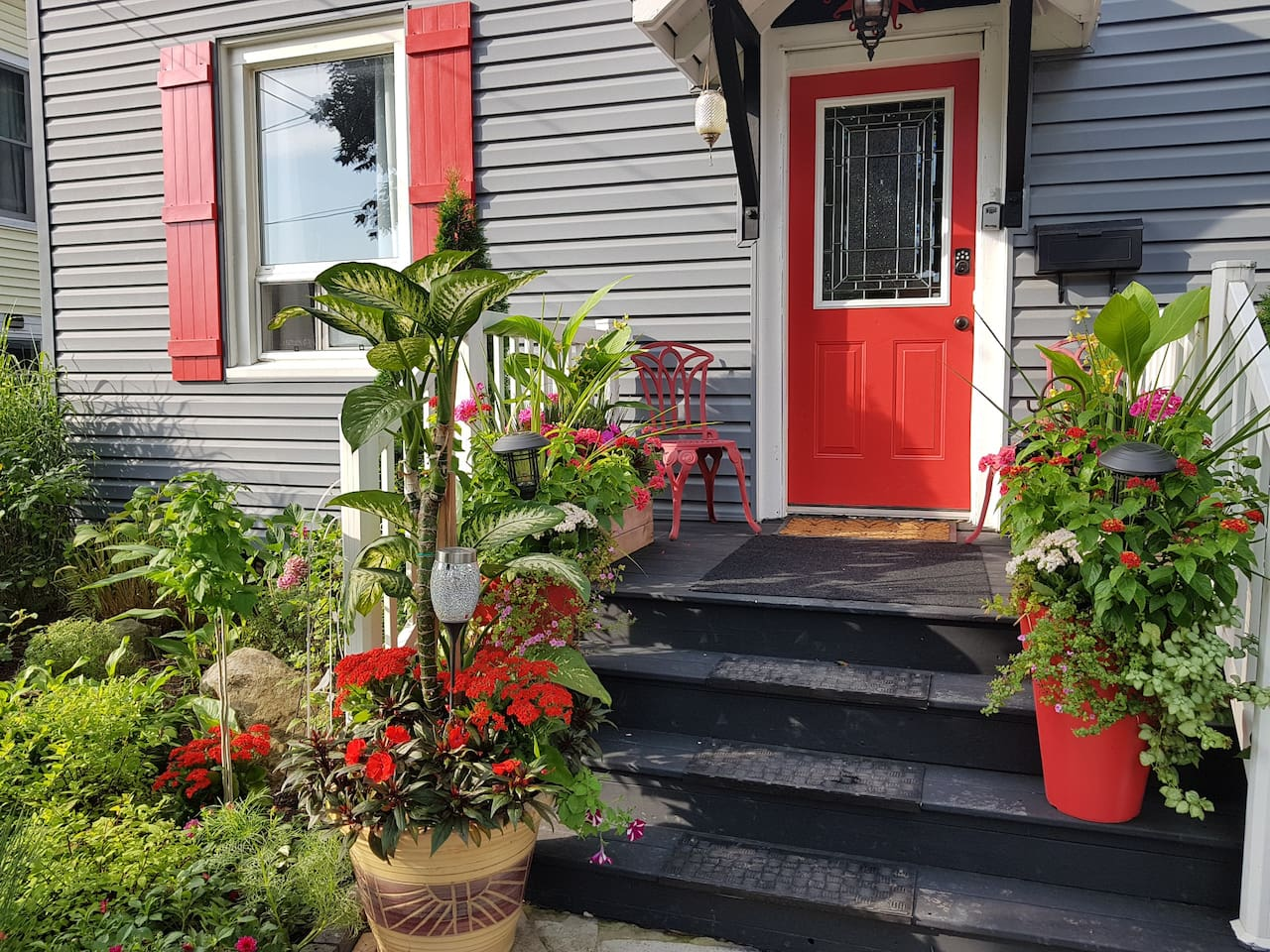 Welcome! Front porch to apartment. Sit with your morning coffee and plan out your day.