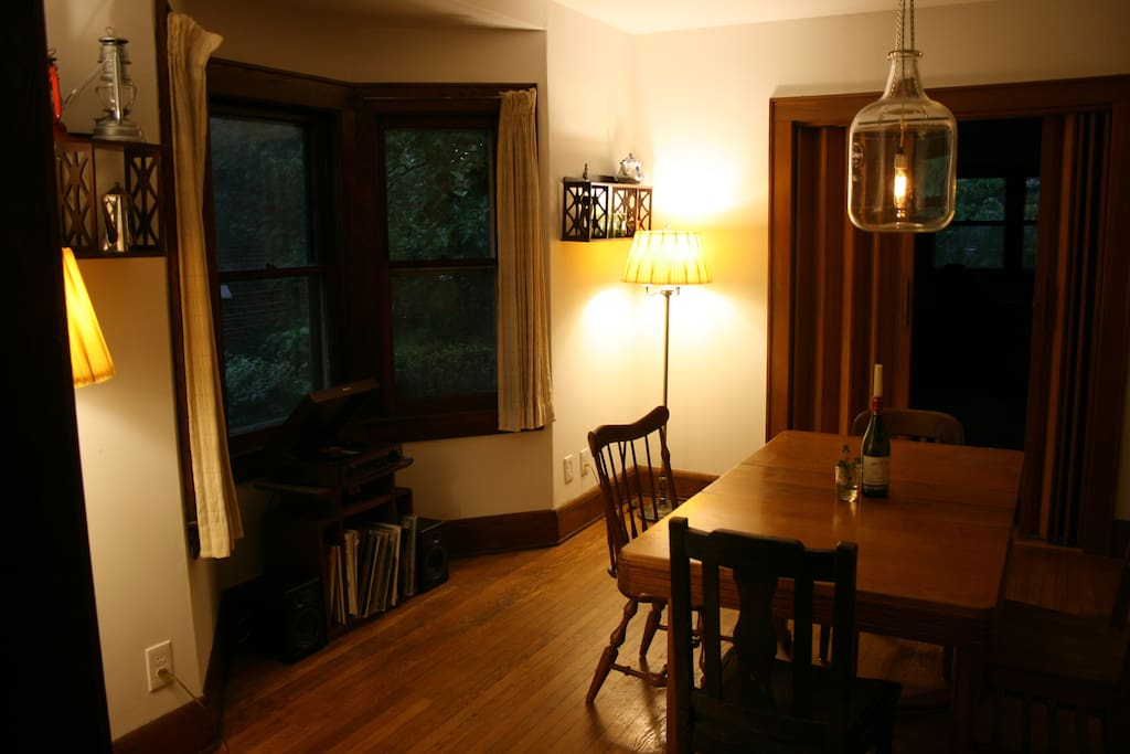 Dining room with bay window; accordion doors lead into office/third bedroom