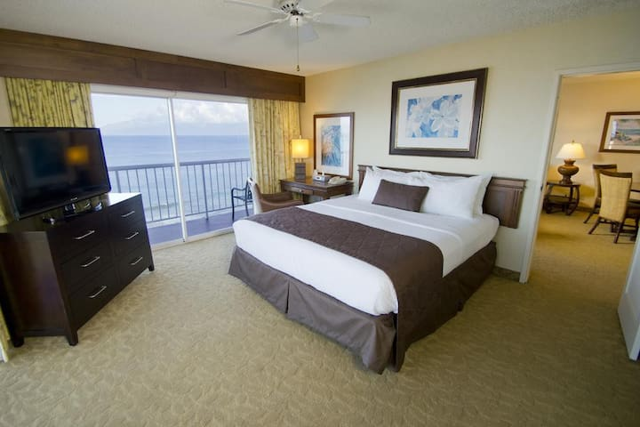 ROOM EXAMPLE: May not be the exact room, but a Deluxe Ocean View suite IS always at the part of building that's closest to the beach, is considered Oceanfront, and have the best views at the resort.