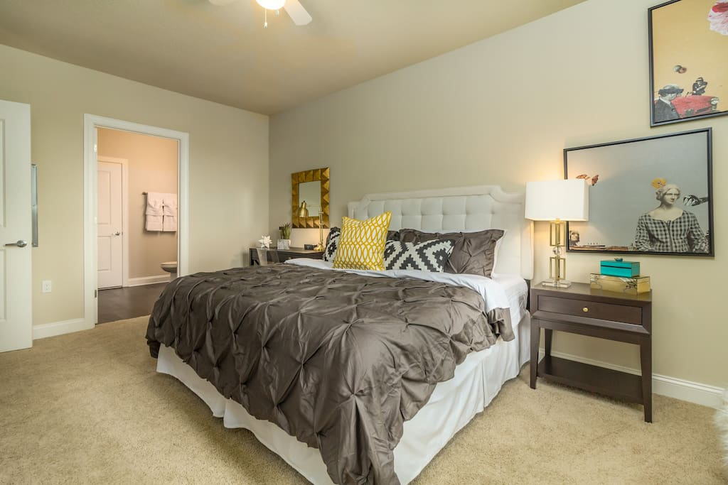 Spacious bedroom with king size bed.