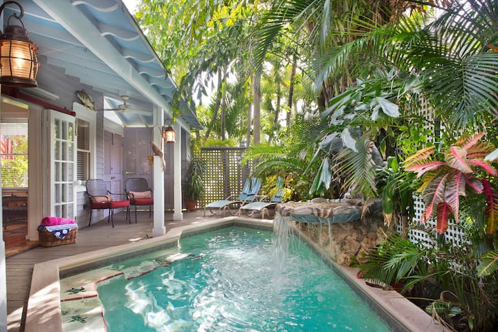 Come enjoy this enchanted private, heated pool with lush tropical surroundings and tranquil waterfall