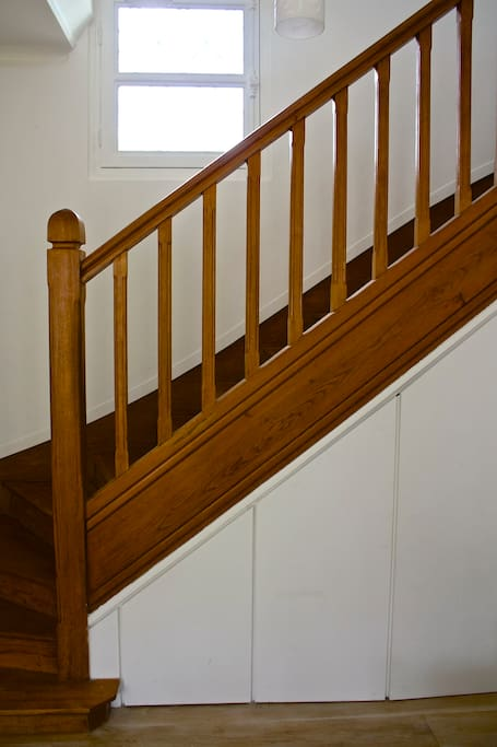 stairs leading to the bedrooms, bathroom and second floor