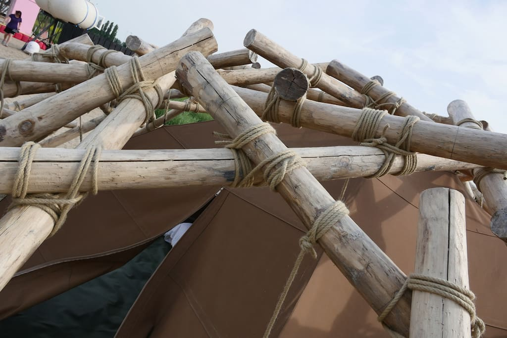 Stacking Sticks - Oscar Sanders - Get rid of all the high tech and return to the simplicity of camp tech in this Leonardo da Vinci-inspired chestnut oak prehistoric tent. Also bookable for 4 people.