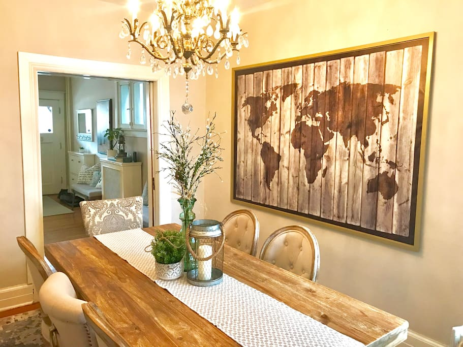 Enjoy family meals or entertain a group with this reclaimed real wood harvest table. Seats eight, features real antique bronze chandelier.