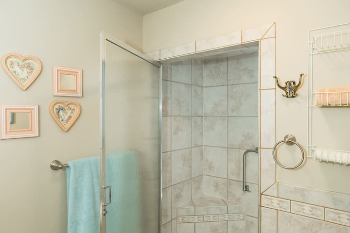 Main bathroom with dressing area and large walk-in shower. May be shared with other guests, when present.