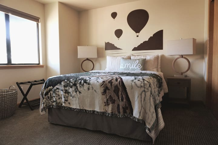 Second bedroom  on the ground floor - queen bed - luggage rack - lamps with built in nightlights - pillow basket - closet with hangers and extra blanket