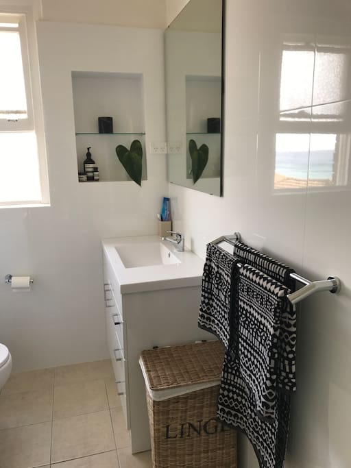 Bathroom with washing machine, shower and ocean views