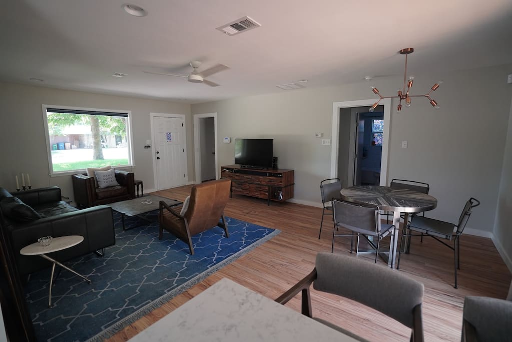 Very open layout with tons of natural light. Shades go up and down, for different levels of privacy.