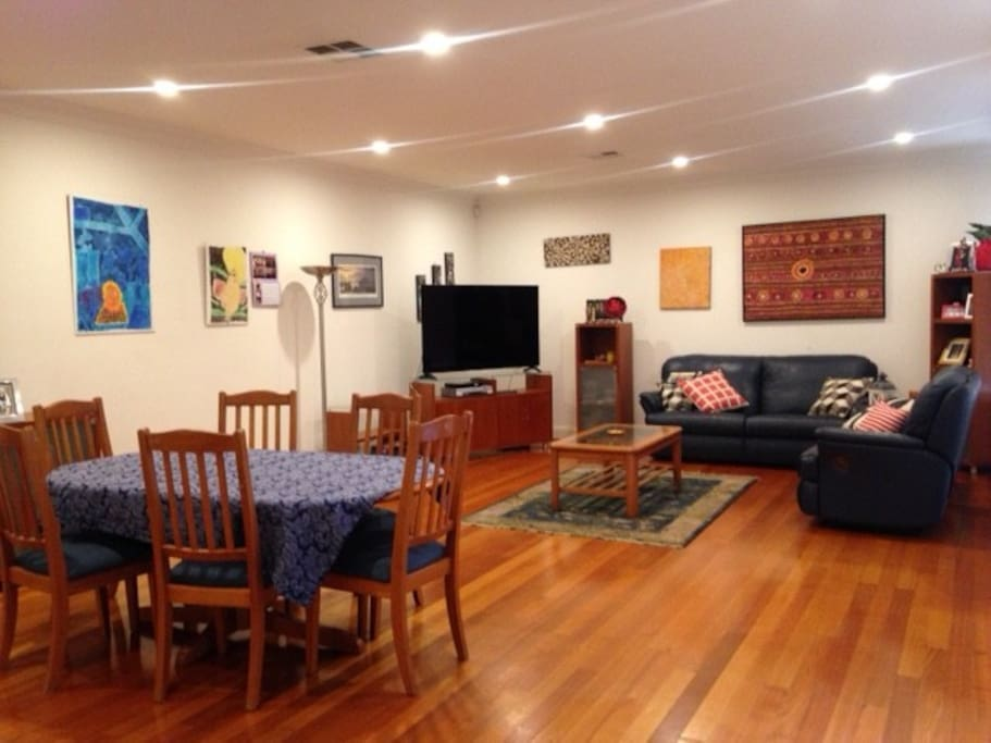 Living room with 6 seat dining suite and entertainment area