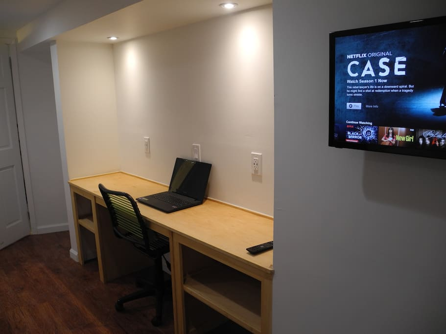 Desk work area and TV