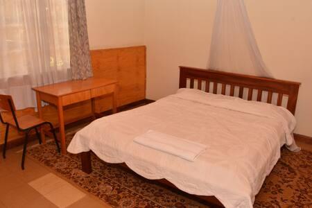 Double bed with an en-suite bathroom.