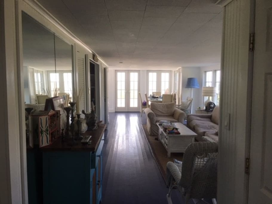 This room is actually bright and surrounded by widows facing the garden, large deck, and full bay views.