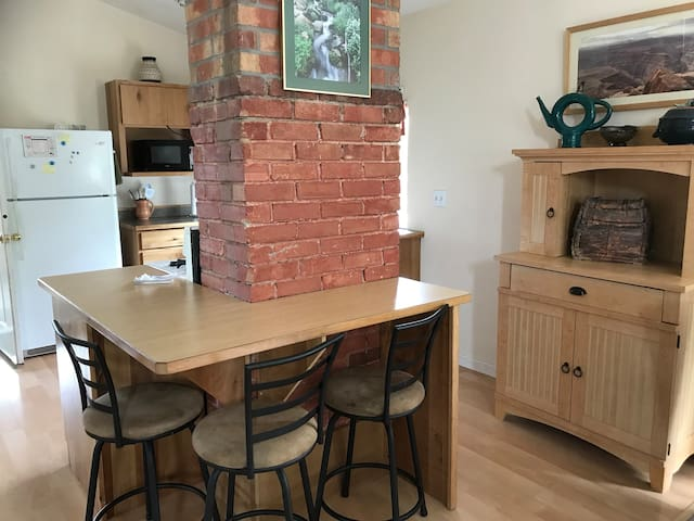Kitchen is fully equipped with dishes, pans, utensils, etc.  Wrap around bar with 3 bar stools, cupboard with games in bottom.