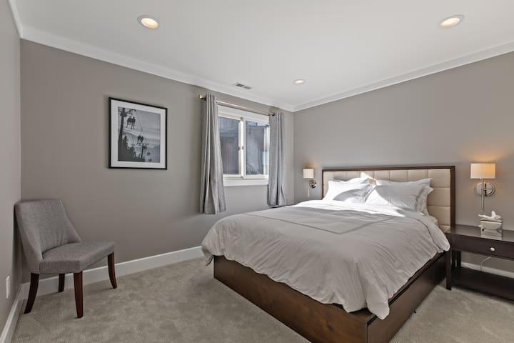 Upstairs master bedroom with queen storage bad and Saatva luxury firm mattress.