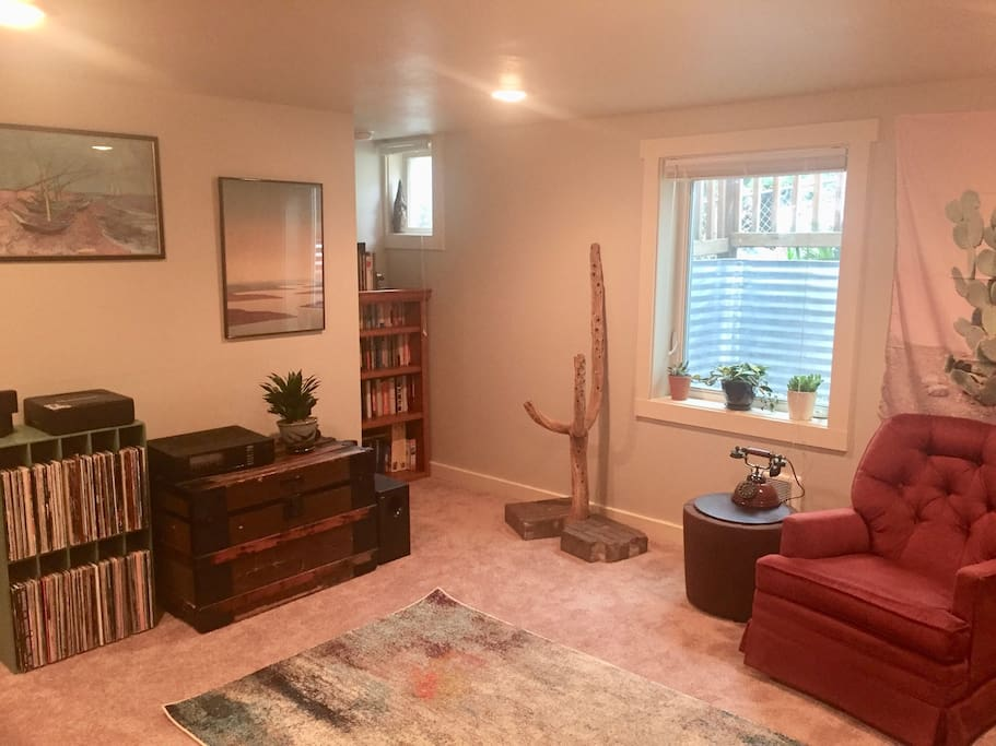 Living room with cactus skeleton, record player, and library