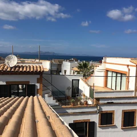House Rooftop view over Village and Alcudia Bay - 2 min. walk to the local quiet sandy beach and a few local quite cafes, bars and restaurants.