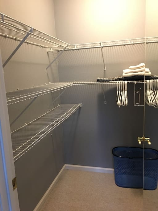 Private & spacious walk-in closet, iron & ironing board inside bedroom