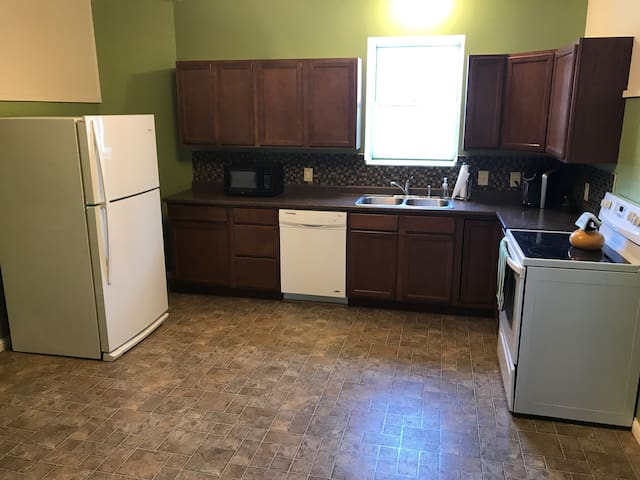 Spacious, fully-furnished kitchen. Includes coffee & tea.