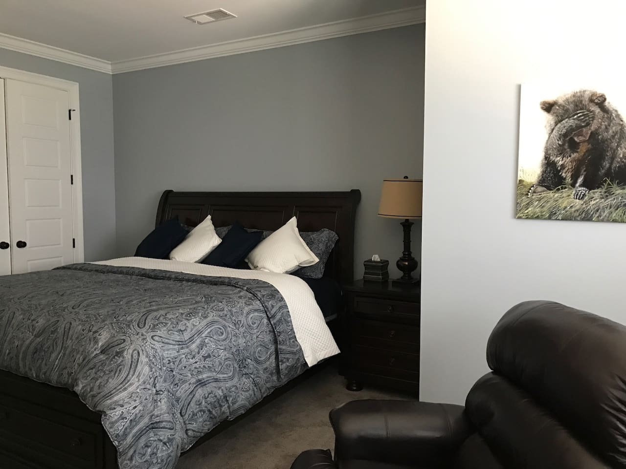 Large bedroom with TV, recliner, King size bed