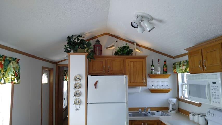 Fully stocked kitchen with modern full size appliances.  Kitchen has everything needed to cook a complete meal.