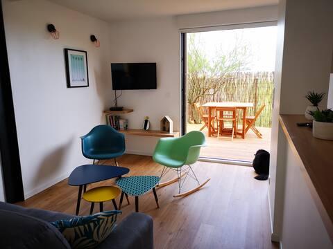 Appartement neuf avec jardin privé bord de mer