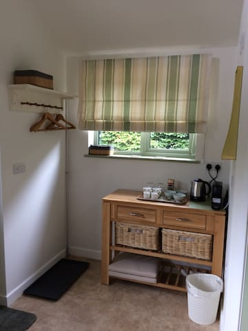 Hanging space and storage. You can store luggage in the adjoining garage if you wish. On request we can provide an iron/ironing board.
