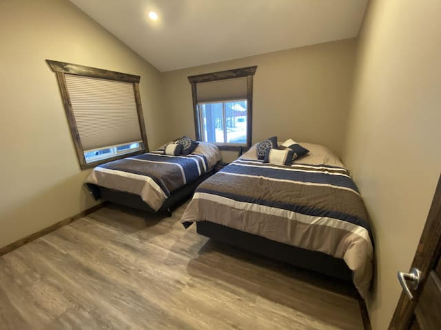 The third bedroom has a double and a queen bed