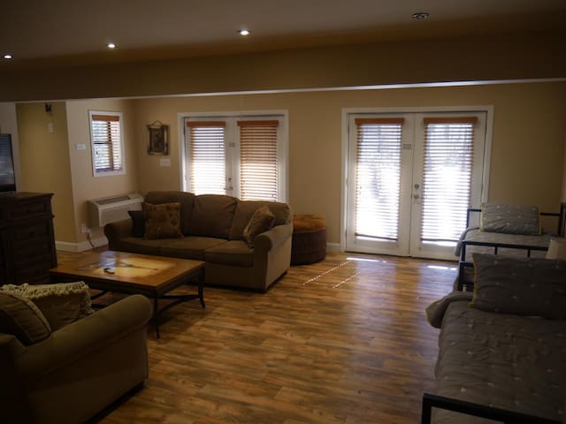 Bedroom 1, level 1, two trundel beds sleeps 4, two sofa's can sleep 4, view of woods