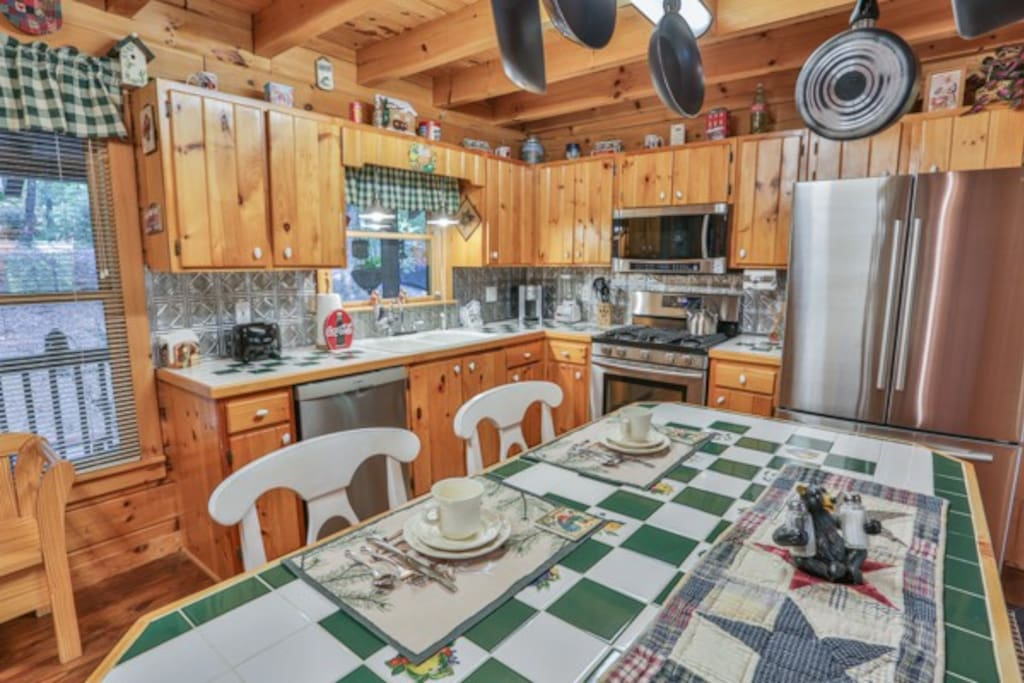 Kitchen with upgraded stainless steel appliances.