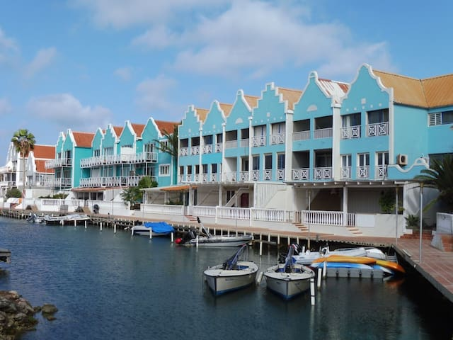 Your home for the week! Arrive at Plaza Resort marina in about 60 seconds by boat with direct access to the Caribbean Sea  p.s. Rent one of the boats pictured here from your neighbor!
