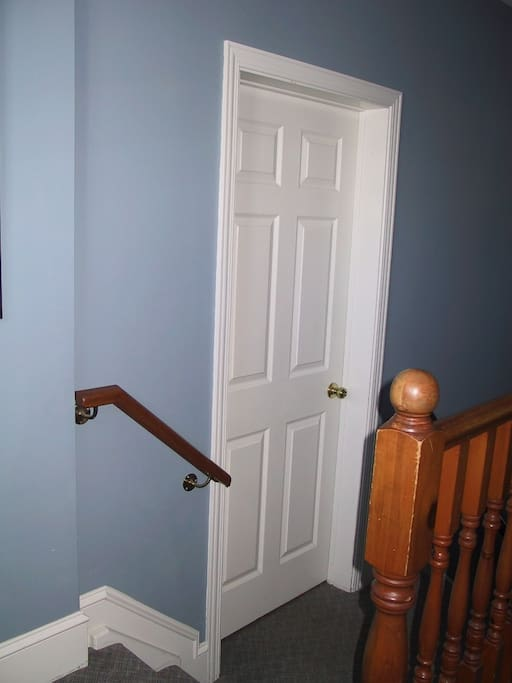 Entry to suite on mezzanine floor of house