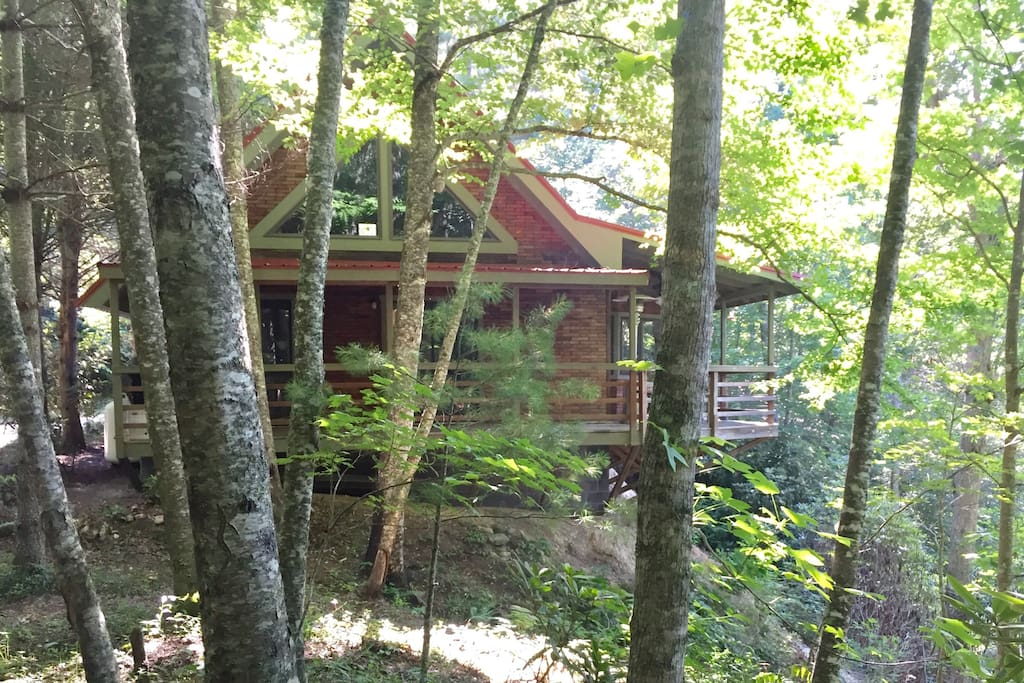 The cabin sits on the hill side looking down on the beautiful South Toe River. The sounds of the river, crickets and birds are so relaxing!!