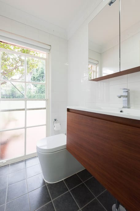 "New bathroom with storage. ""As my first AirBNB experience I wasn't sure what to expect. Jane was a lovely host, friendly and welcoming. The room felt homely while being of a very high standard with the bonus of a well appointed ensuite. The bed was very comfortable too. I would highly recommend Jane's place."" Grant, April 2017"