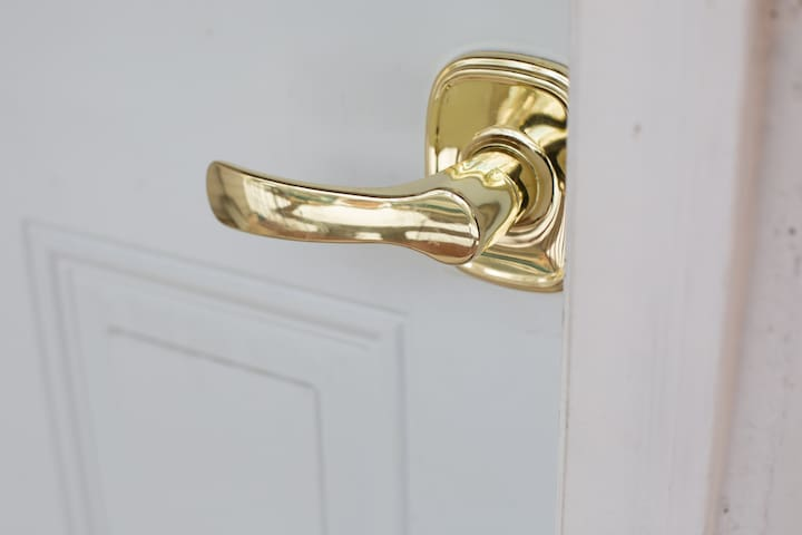 Door handle that opens with a push or pull; handy if you come with all hands filled.