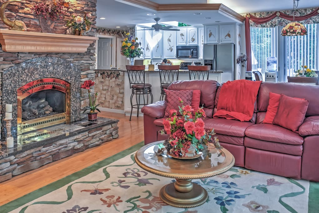 Relax and unwind in the spacious, open living area , complete with a handsome fireplace!