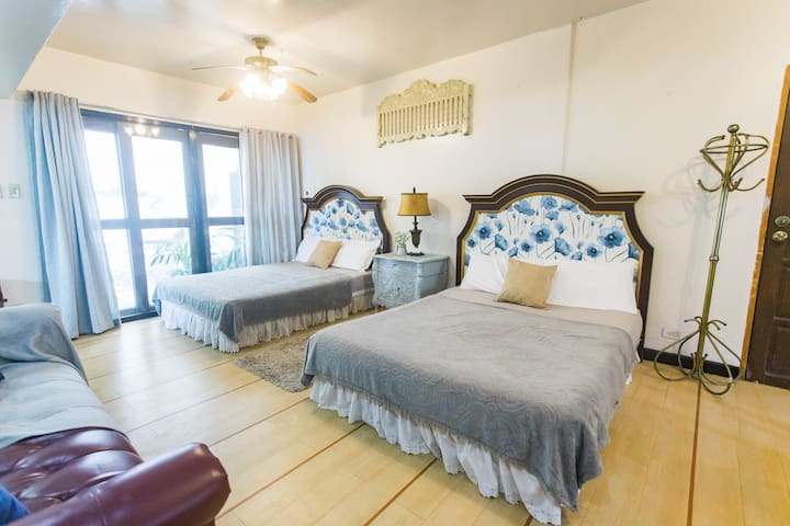 Large master's bedroom on the first floor with 3 queen sized beds, aircon, toilet & bath.