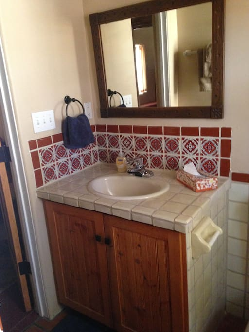 In suite bath with Mexican tile.
