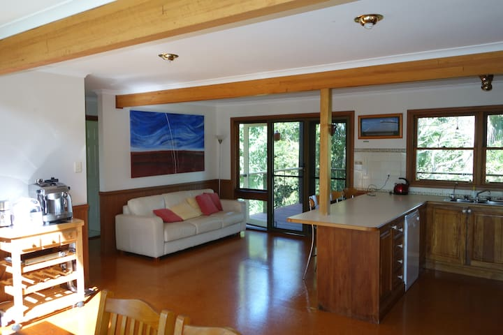 Open kitchen and dining area with deck access