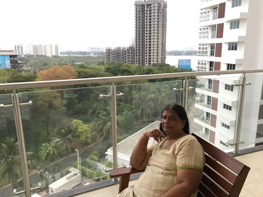 This is the balcony adjacent to Living room where we can get a view of the sea and Bird sanctuary. It also has a hanging swing for comfort. We can view the gardens and clubs and other activities on the ground
