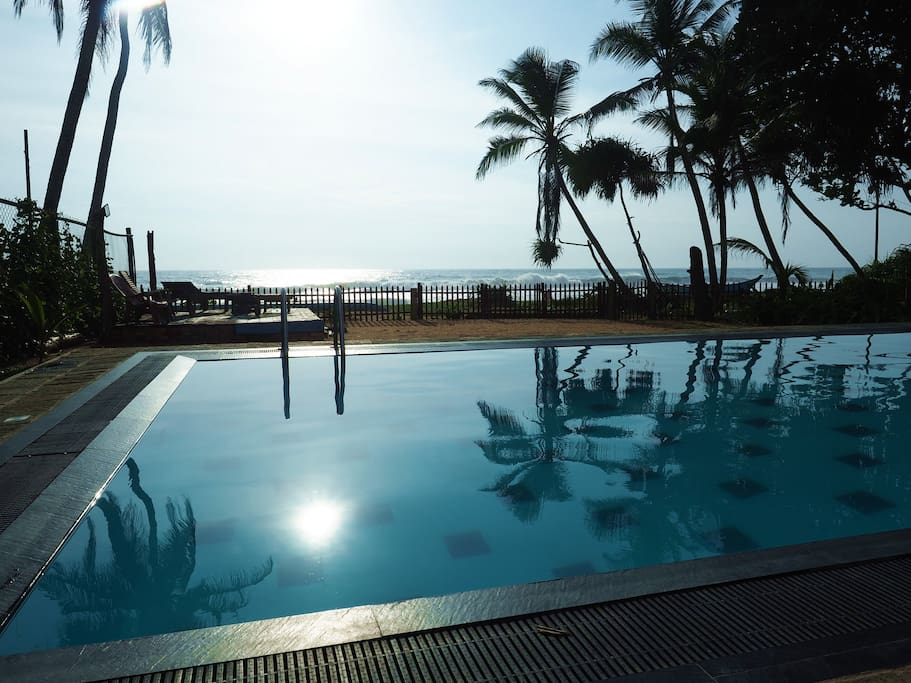 Ocean view across the swimming pool.