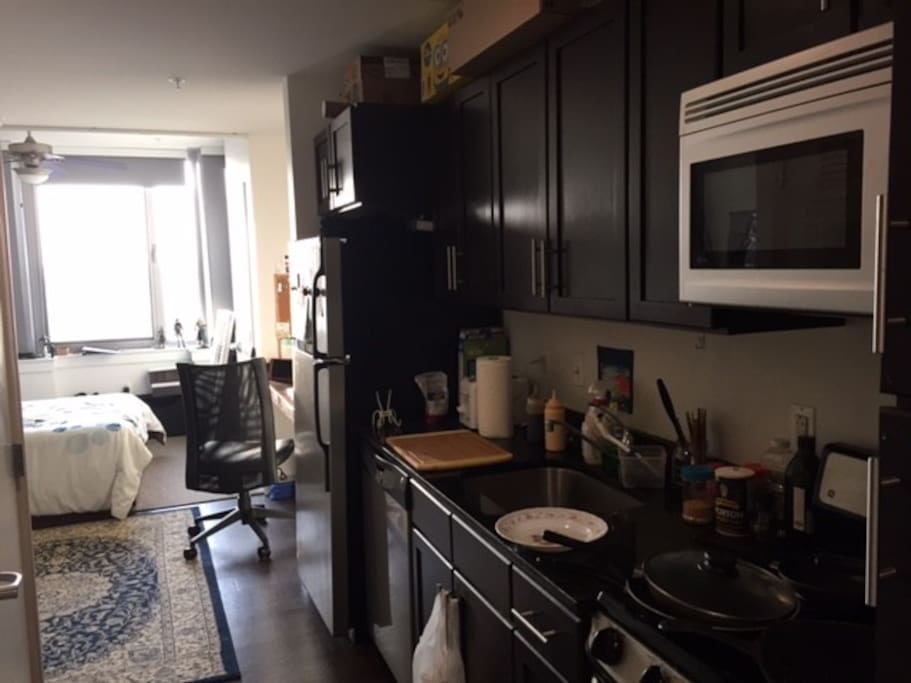 Kitchenette with fridge and microwave (plates, pots, and utensils not included)